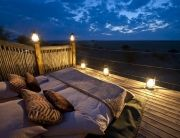 Kalahari Plains Camp overlooks an immense pan with endless horizons and beautiful skies. The 8 en-suite canvas units have a sleep-out above each to enjoy moonlit or star-studded nights, Kalahari, Botswana.
