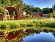 Okuti's spacious curved mosasas are located on raised teak decks with River View, Moremi Game Reserve, Botswana.