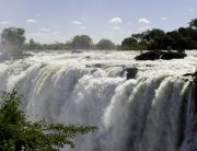 Toka Leya Camp lies in the Mosi-oa-Tunya National Park, overlooking the mighty Zambezi River. Excellent activities offered: Visit the close-by world wonder Victoria Falls, enjoy Rhino Tracking, Sunset Boat Cruise, Game Drives and Cultural Visits. Zambia, Wilderness Safaris.