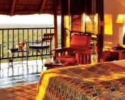 Relax at one of the Victoria Falls Safari Lodges' luxury rooms and enjoy stunning vistas from your private deck, Victoria Falls, Zimbabwe.