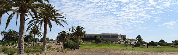 The Rossmund Golf Course, A view of the course, clubhouse and some springbok. Image by Rossmund Golf Resort and Lodge, Golf Courses of Namibia