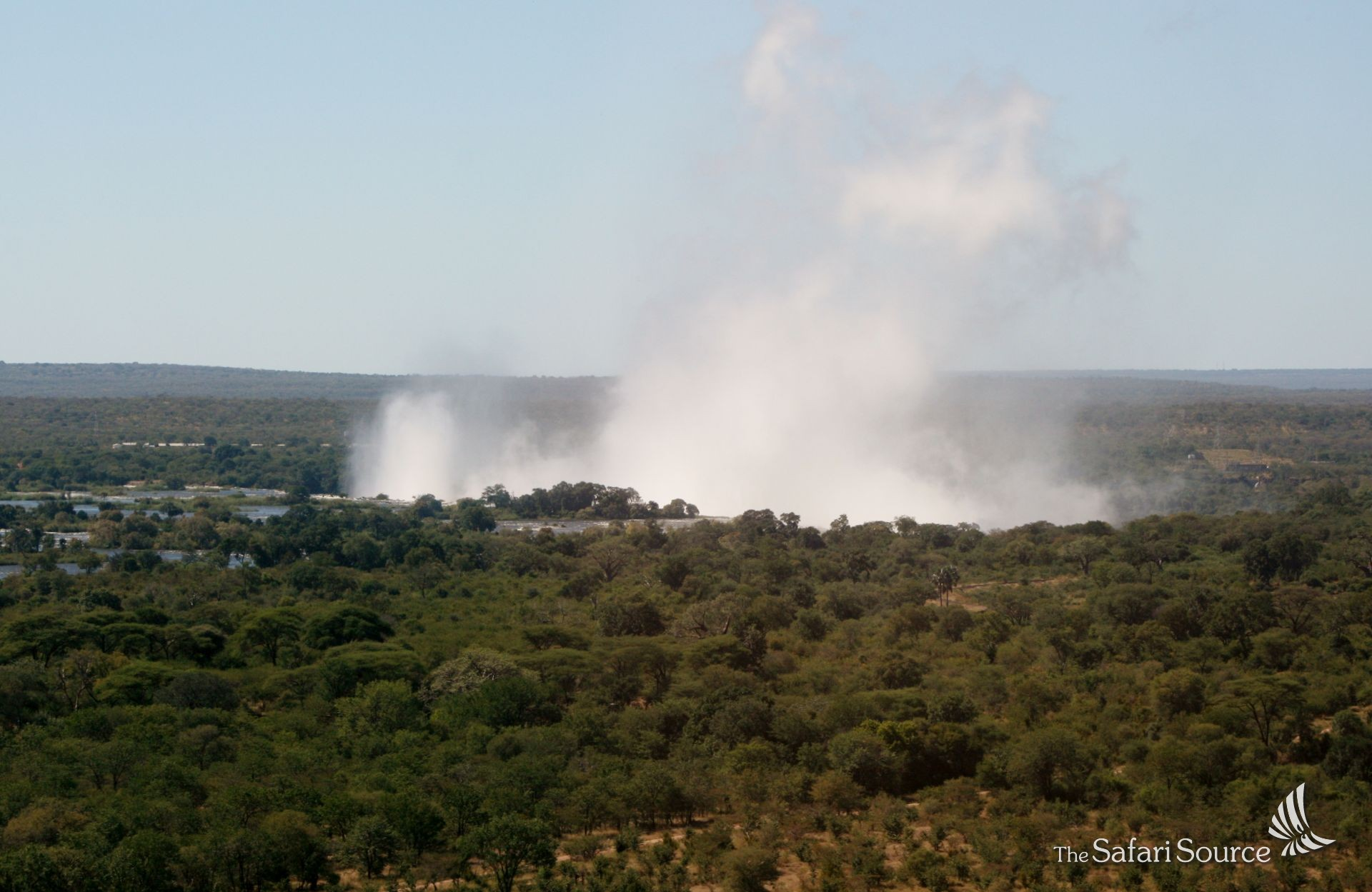 The Spray of the Victoria Falls is visible from far away during Green Season, Rainy Season, in Zimbabwe.