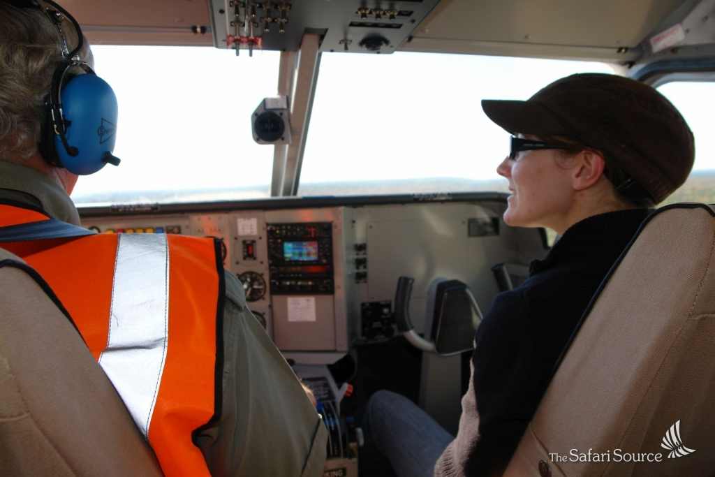 Monika sitting next to the Pilot, learning about flying in the Bush