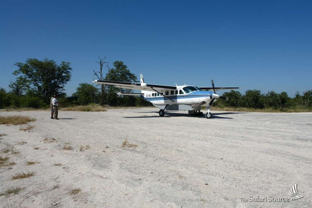 Guests waiting for the Departure of a Chessna on a Bush Runway.