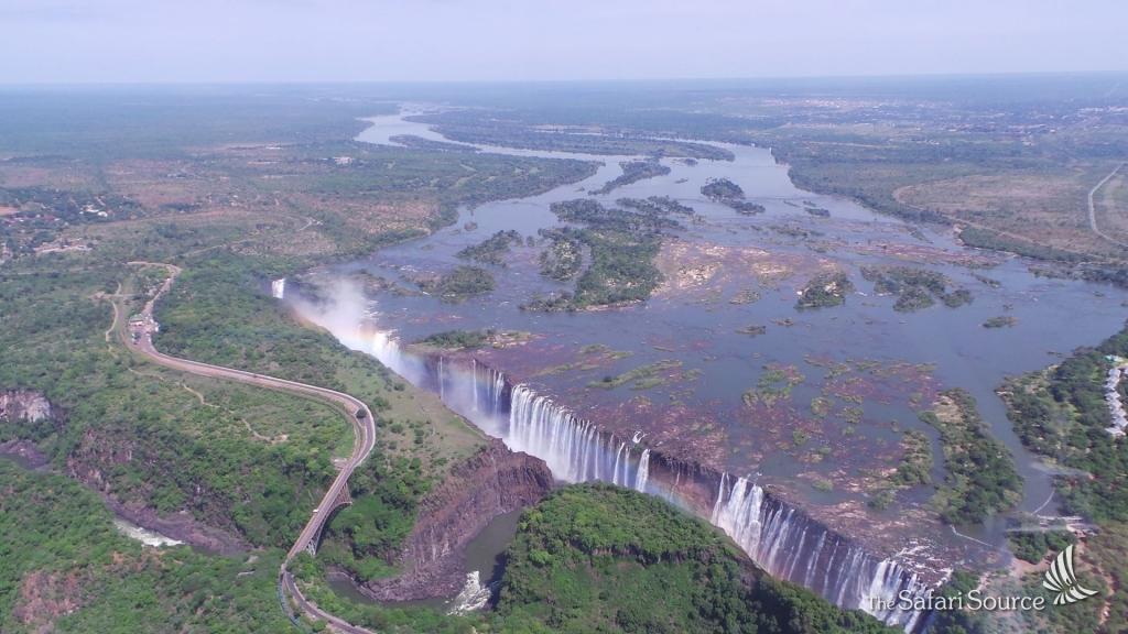 Helicopter Flight over the Victoria Falls, Aerial View of the Victoria Falls, Zimbabwe, Zambia, Zambezi River, Victoria Falls Bridge, Gorge, natural border between Zambia and Zimbabwe.