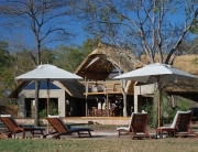 Elephants Eye Lodge in Hwange National Park, Zimbabwe. Main Area with Bar, Lounge, Pool and Viewing Deck. Luxury Safar Accommodation.