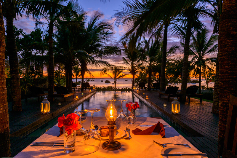 Dinner at sunset by the pool of Ibo Island Lodge